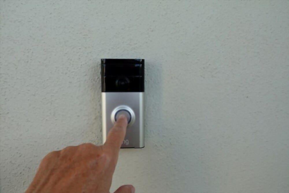 A person ringing ring dorrbell