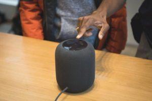 Man Showing Apple HomePod