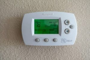 Honeywell thermostat installed at wall